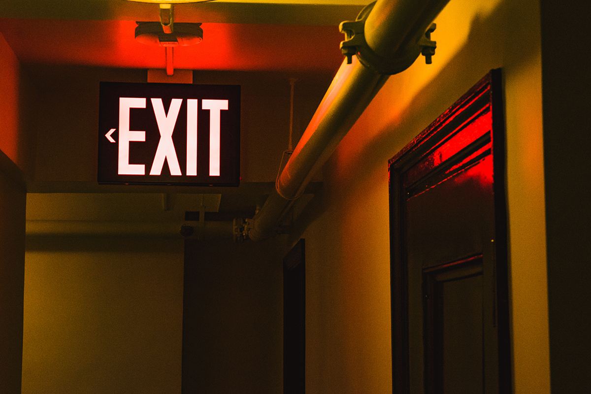 Exit sign lighting and illumination